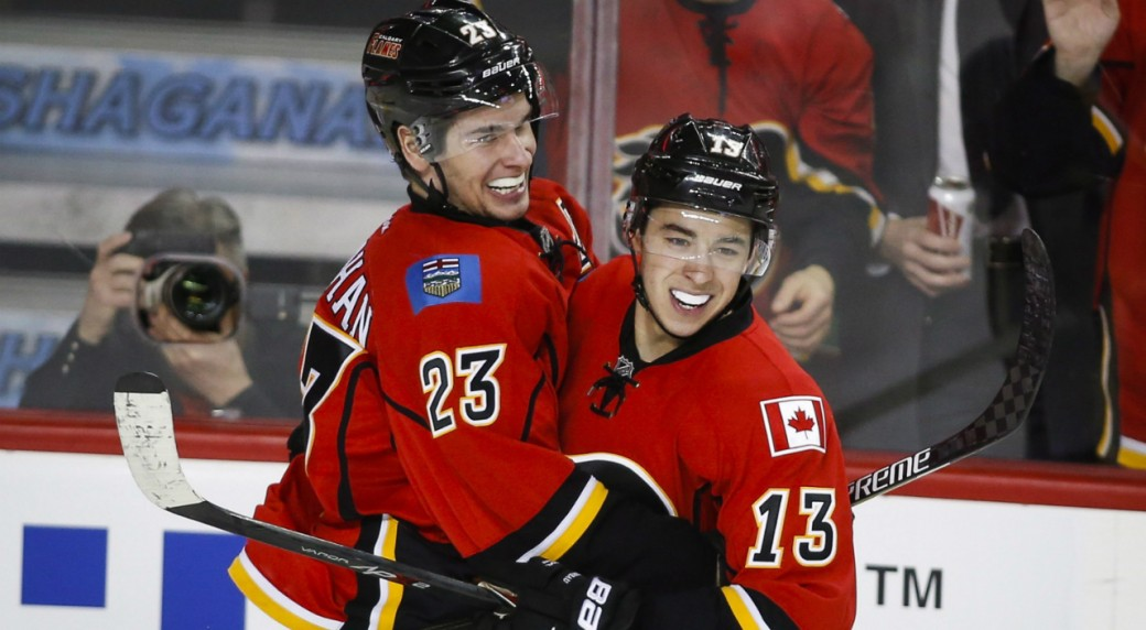 Calgary-Flames'-Sean-Monahan,-left,-celebrates-his-goal-with-teammate-Johnny-Gaudreau-during-third-period-NHL-hockey-action-against-the-Carolina-Hurricanes-in-Calgary,-Wednesday,-Feb.-3,-2016.THE-CANADIAN-PRESS/Jeff-McIntosh