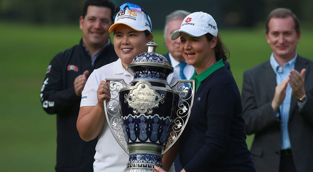 South Korea's Inbee Park, left poses with her trophy and Lorena Ochoa, right, at the end of the LPGA Lorena Ochoa Invitational in Mexico City.