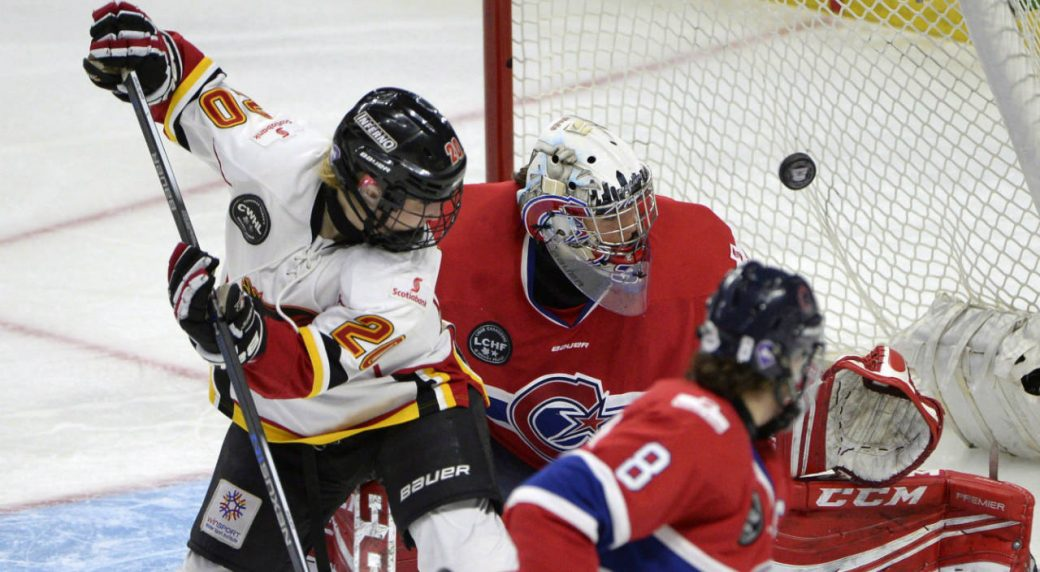 Calgary Inferno s Jessica Campbell (20) watches her shot go in the net past  Les Canadiennes de Montreal goalie Charline Labonte (32) during the third  period ... 135b4fda2b