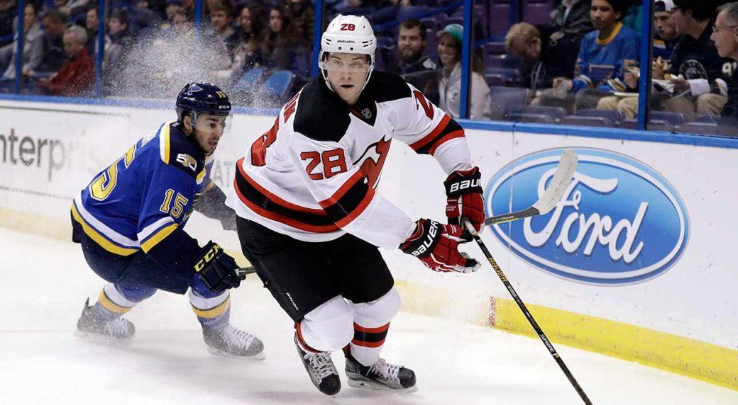 New Jersey Devils  Damon Severson (28) handles the puck. (Jeff Roberson AP) 8c7d1237e
