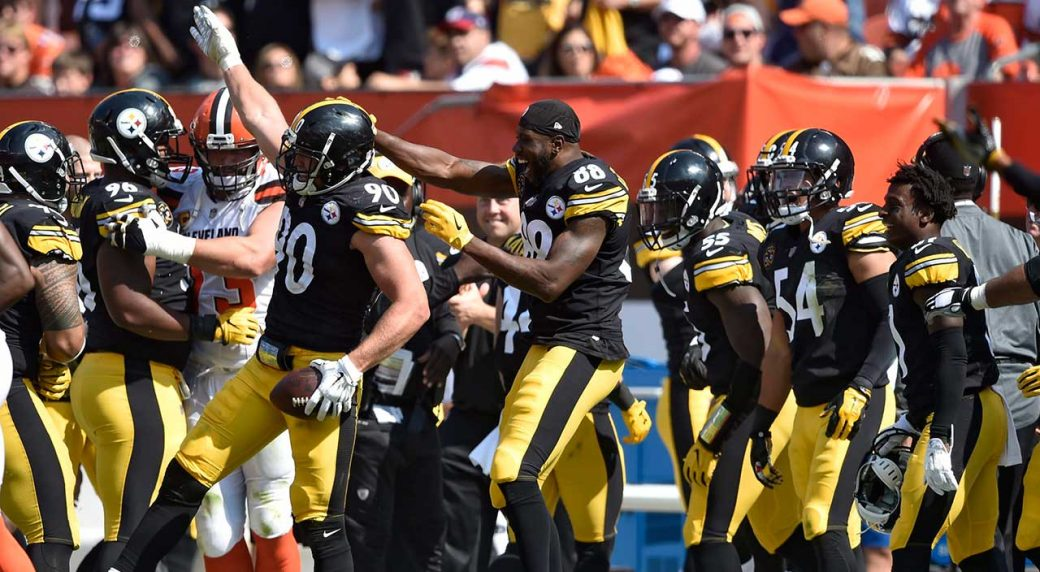 9318a5e32ca Pittsburgh Steelers linebacker T.J. Watt (90) celebrates with teammates  after making an interception during the second half against the Cleveland  Browns