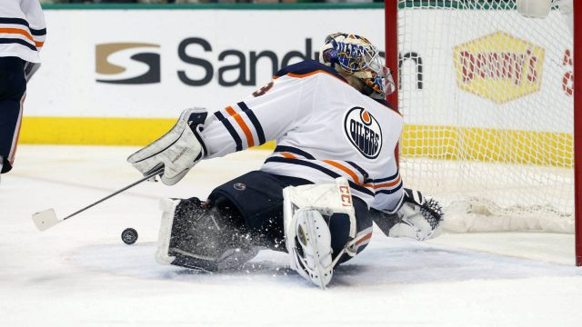 Edmonton-Oilers-goaltender-Cam-Talbot-(33)-has-a-Dallas-Stars-shot-bounce-away-from-the-goal-during-the-second-period-of-an-NHL-hockey-game-in-Dallas,-Saturday,-Jan.-6,-2018.-(Michael-Ainsworth/AP)