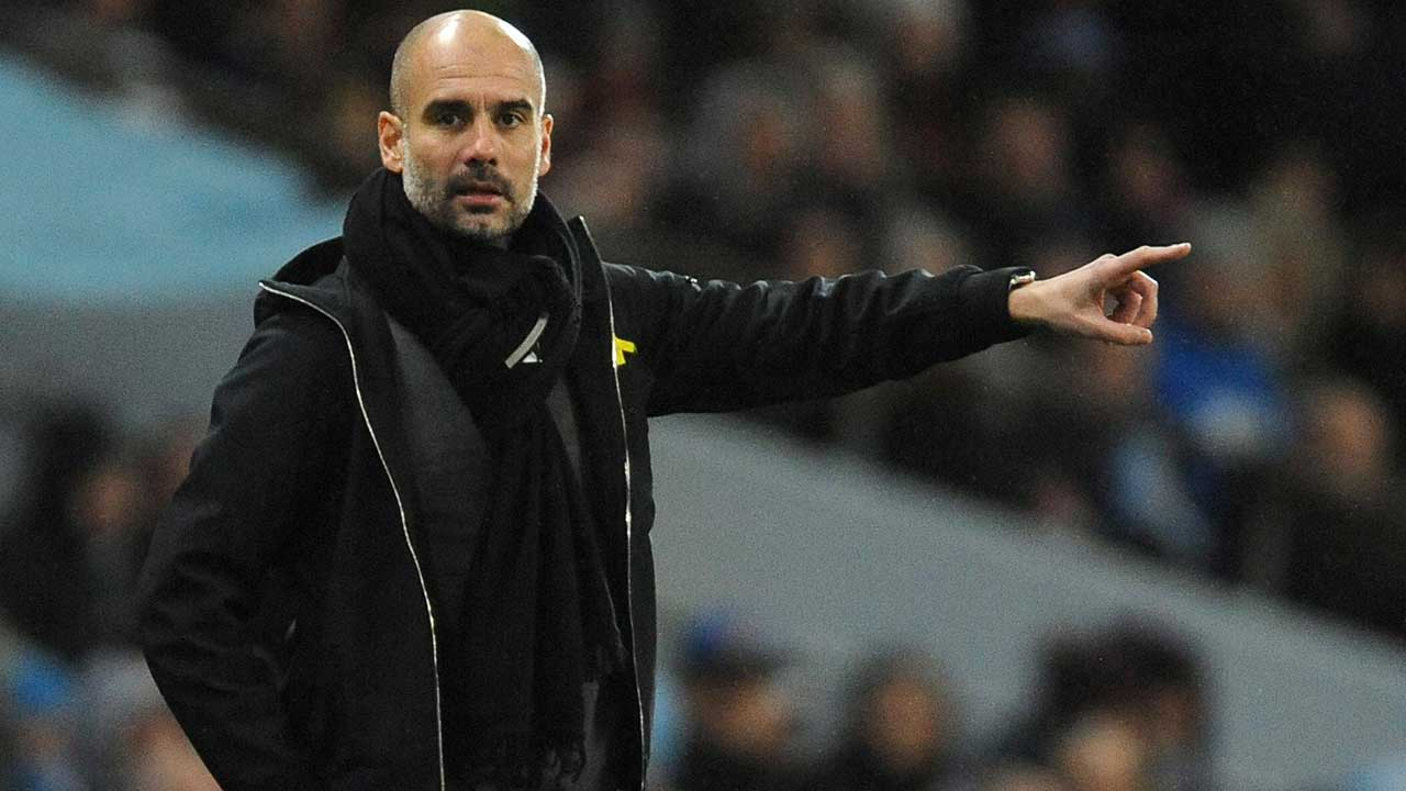 Man City signs Pep Guardiola to new three-year deal