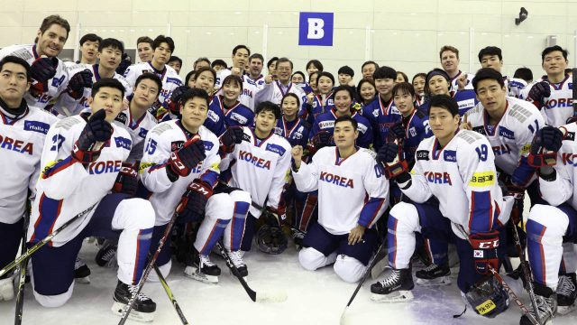 South-Korean-President-Moon-Jae-in,-center-top,-poses-with-South-Korean-women's-and-men's-ice-hockey-team-players-during-a-visit-to-Jincheon-National-Training-Center-in-Jincheon,-South-Korea,-Wednesday,-Jan.-17,-2018.-There-is-growing-concern-in-South-Korea-that-a-proposal-to-form-a-joint-women's-hockey-team-with-North-Korea-for-the-Olympics-could-be-bad-for-the-South-Korean-players.-(Ha-Sa-hun/Yonhap-via-AP)