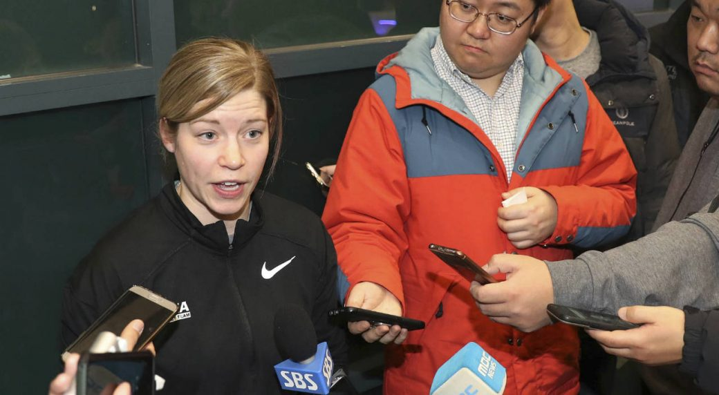 """In-this-Tuesday,-Jan.-16,-2018,-photo,-South-Korean-women's-hockey-team-head-coach-Sarah-Murray-speaks-as-she-returns-from-the-team's-U.S.-training-camp,-at-Incehon-International-Airport-in-Incheon,-South-Korea.-There-is-growing-concern-in-South-Korea-that-a-proposal-to-form-a-joint-women's-hockey-team-with-North-Korea-for-the-Olympics-could-be-bad-for-the-South-Korean-players.-""""Adding-somebody-so-close-to-the-Olympics-is-a-little-bit-dangerous-just-for-team-chemistry-because-the-girls-have-been-together-for-so-long,""""-she-said.-(Ha-Sa-hun/Yonhap-via-AP)"""
