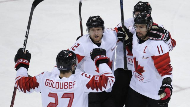 Chris-Kelly-(11),-of-Canada,-celebrates-with-his-teammates-after-scoring-a-goal-against-the-Czech-Republic-during-the-first-period-of-the-men's-bronze-medal-hockey-game-at-the-2018-Winter-Olympics-in-Gangneung,-South-Korea,-Saturday,-Feb.-24,-2018.-(Julio-Cortez/AP)
