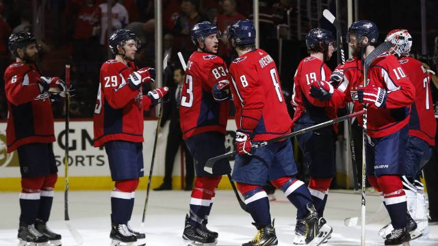 Washington-Capitals-left-wing-Alex-Ovechkin-(8),-from-Russia-celebrates-with-his-teammates-at-the-end-of-Game-6-of-the-NHL-Eastern-Conference-finals-hockey-playoff-series-against-the-Tampa-Bay-Lightning,-Monday,-May-21,-2018,-in-Washington.-Capitals-won-3-0.-(Pablo-Martinez-Monsivais/AP)