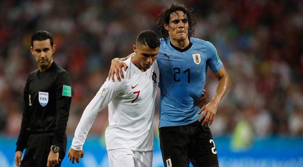 de24108d6 Portugal s Cristiano Ronaldo helps injured Uruguay s Edinson Cavani off the  pitch during the Round of 16 match at the 2018 World Cup at the Fisht  Stadium in ...