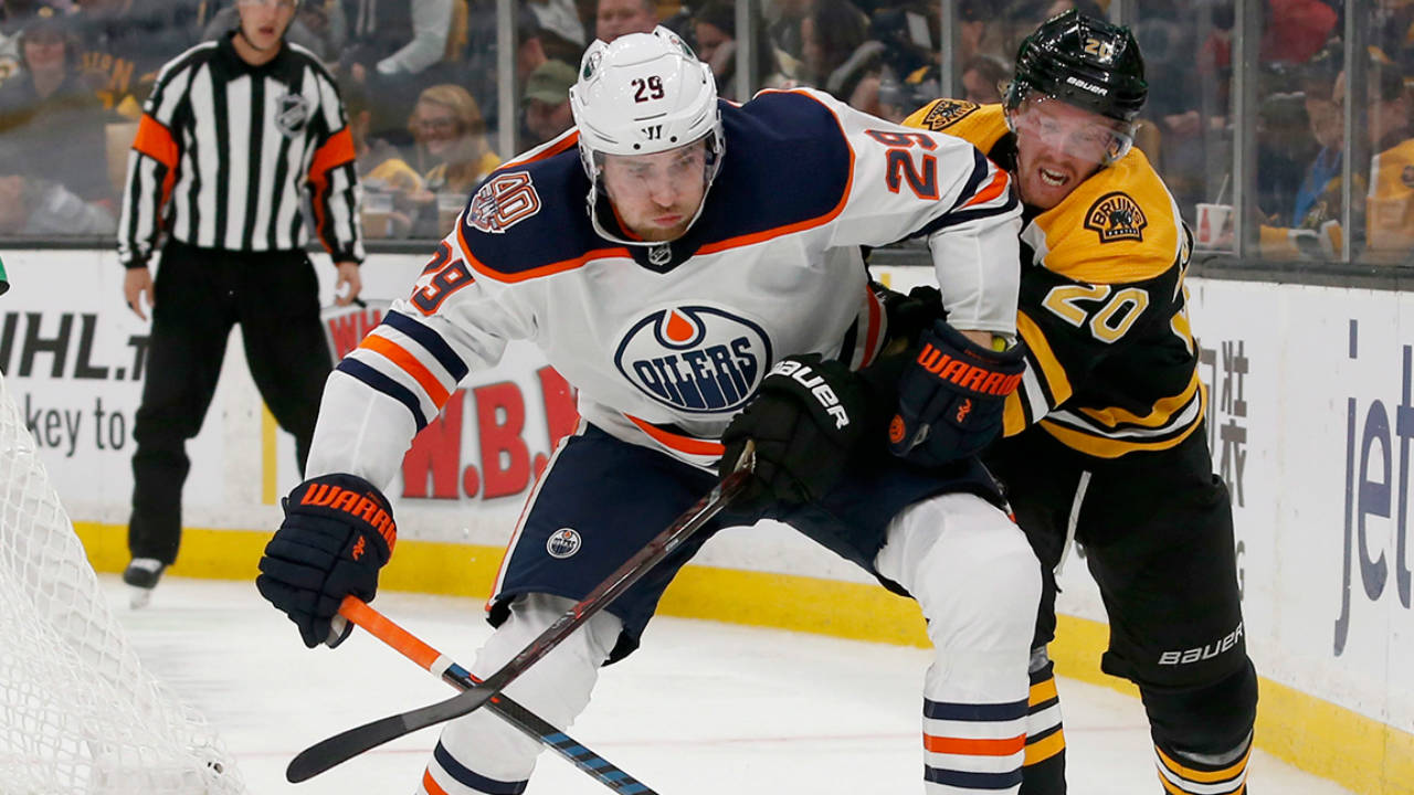 Oilers-leon-draisaitl-looks-to-clear-puck-against-bruins-1