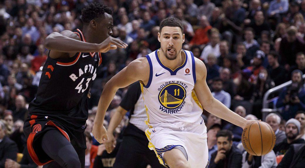 Golden-State-Warriors-guard-Klay-Thompson-drives-against-Toronto-Raptors-forward-Pascal-Siakam