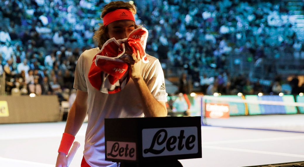 stefanos-tsitsipas-wipes-his-face-with-a-towel