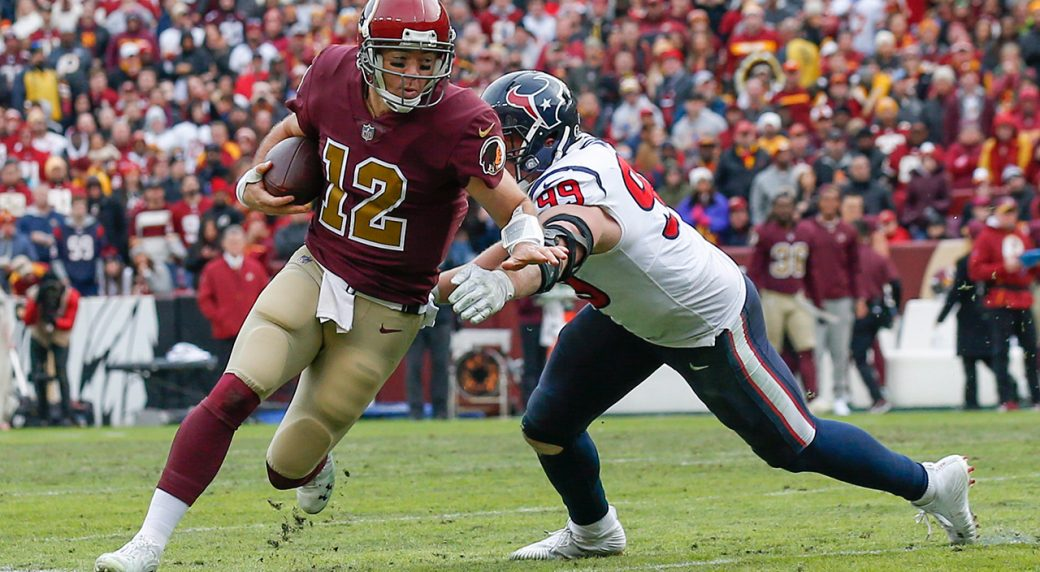 e57d072caa3 Washington Redskins quarterback Colt McCoy (12) scrambles past Houston  Texans defensive end J.J. Watt (99) during the second half