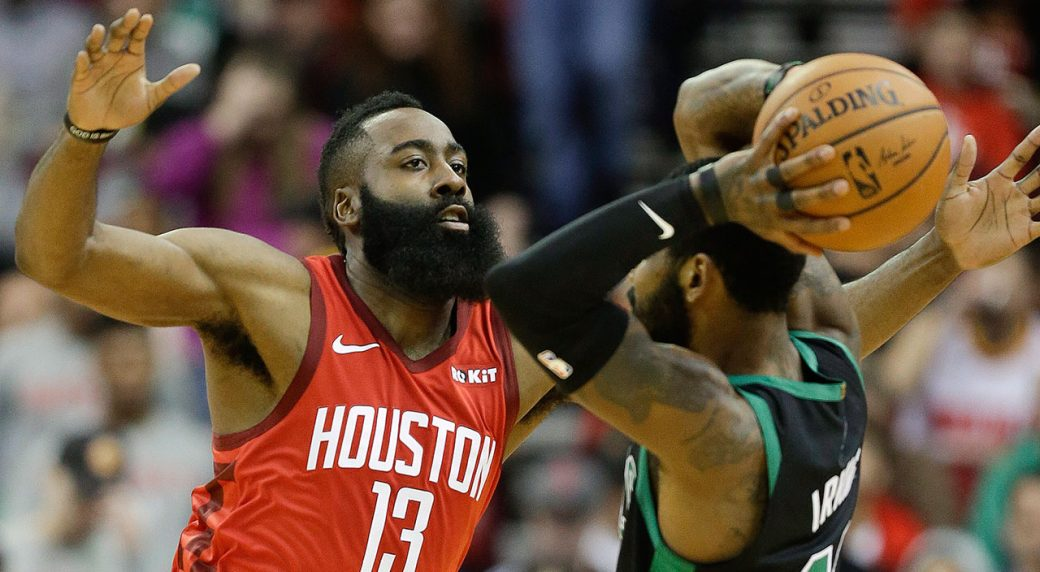 71a8cf93a54 Houston Rockets guard James Harden (13) applies defensive pressure against  Boston Celtics guard Kyrie Irving during the first half of an NBA  basketball game ...