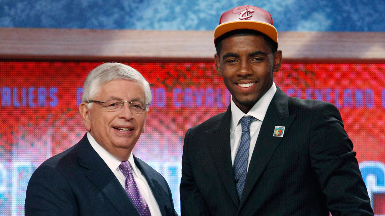 NBA Commissioner David Stern left poses with the No. 1 overall draft pick Kyrie Irving