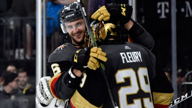colin-miller-celebrates-with-marc-andre-fleury