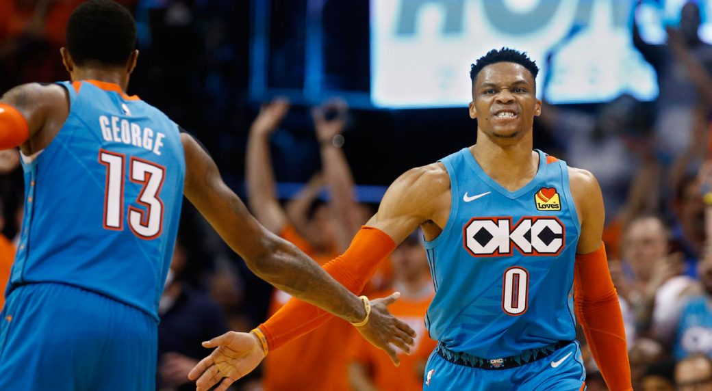 e2d2e22bfd6 Oklahoma City Thunder guard Russell Westbrook (0) celebrates with Paul  George (13) after a basket during the second half of Game 3 of the team's  NBA ...