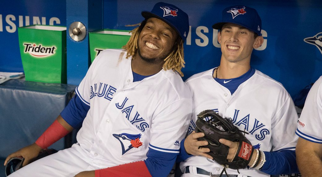 a879e58eb9 ... with teammate Vladimir Guerrero Jr. smile prior to the start of their  Interleague MLB baseball game against the Sand Diego Padres in Toronto  Friday May ...